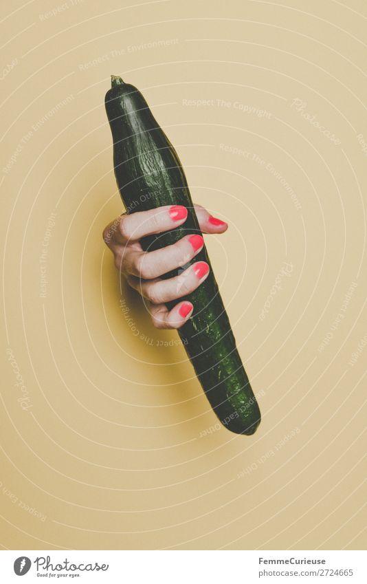 Hand of a woman holding a cucumber Mensch Gesunde Ernährung grün rot Lebensmittel gelb feminin Design ästhetisch Finger Gemüse Penis Gurke Nagellack