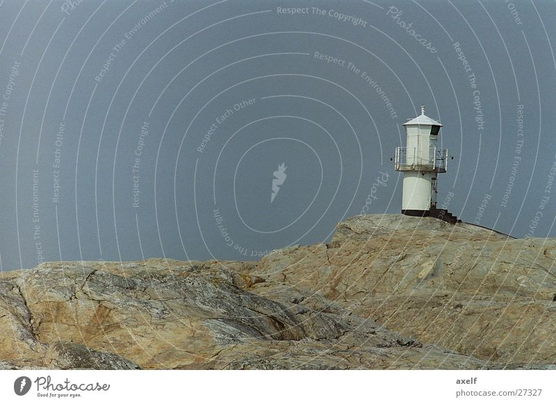 Leuchtturm Meer Einsamkeit leer Ferne Felsen
