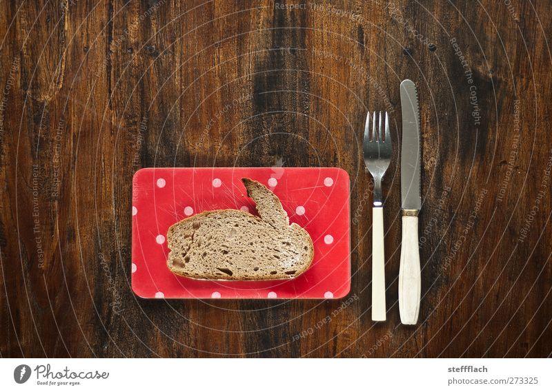 Osterhasenbrot Tier Holz Ernährung Lebensmittel Tisch Ostern Küche Kitsch Jagd Frühstück Brot Hase & Kaninchen Teller Surrealismus Messer Besteck