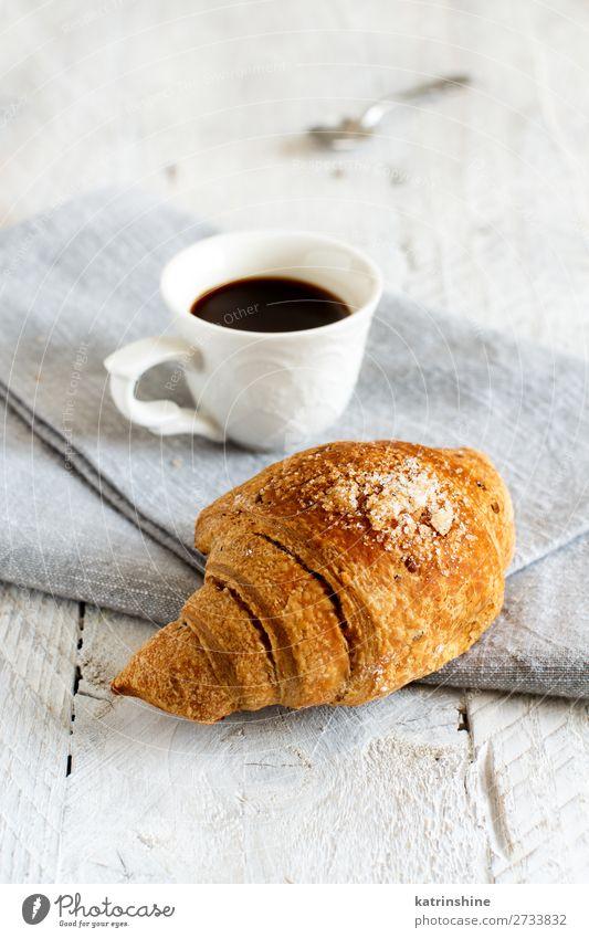 Frühstück mit Kaffee und Croissant Brot Dessert Getränk Espresso Löffel Tisch frisch lecker braun weiß Tradition Hintergrund Bäckerei Koffein Kochen Tasse