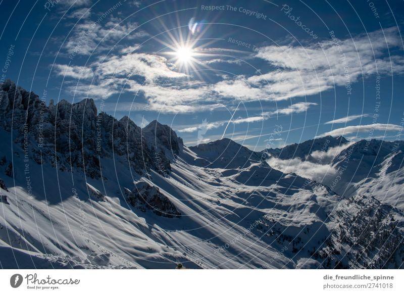 Bergpanorama im Winter Berge Alpen Ausblick Schnee Sonne Blendeneffekt Berge u. Gebirge Himmel Wolken blau Felsen Eis Gipfel Panorama (Aussicht) Natur
