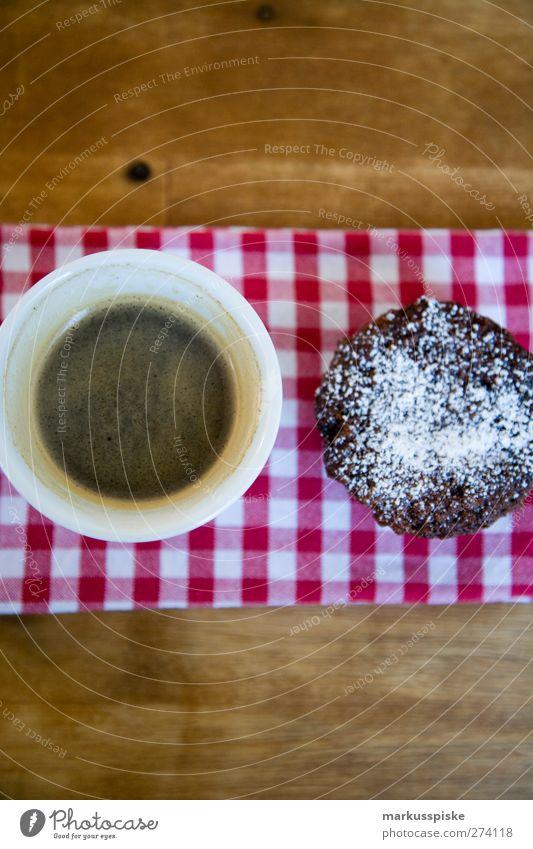 schoko muffin mit kaffee schwarz Lebensmittel Teigwaren Backwaren Süßwaren Muffin Cupcake süß Puderzucker Schokolade Ernährung Frühstück Kaffeetrinken