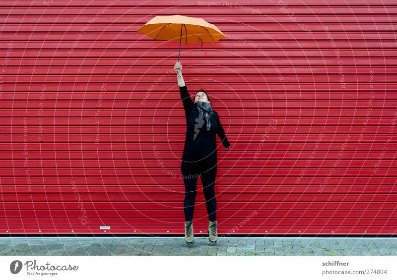 bitti Poppins reloaded | UT S/HD 2012. Mensch Frau Jugendliche rot Erwachsene feminin Junge Frau springen orange Wetter fliegen hoch frei verrückt festhalten stoppen