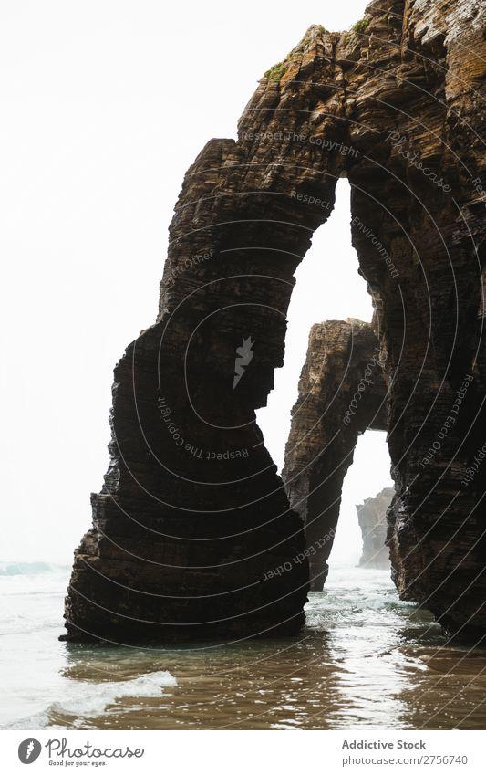 Höhlenlandschaft Klippe Meer Natur Ferien & Urlaub & Reisen Himmel Mensch Mann Felsen Stein Küste Bucht Aussicht schön Idylle malerisch Gelassenheit Wasser