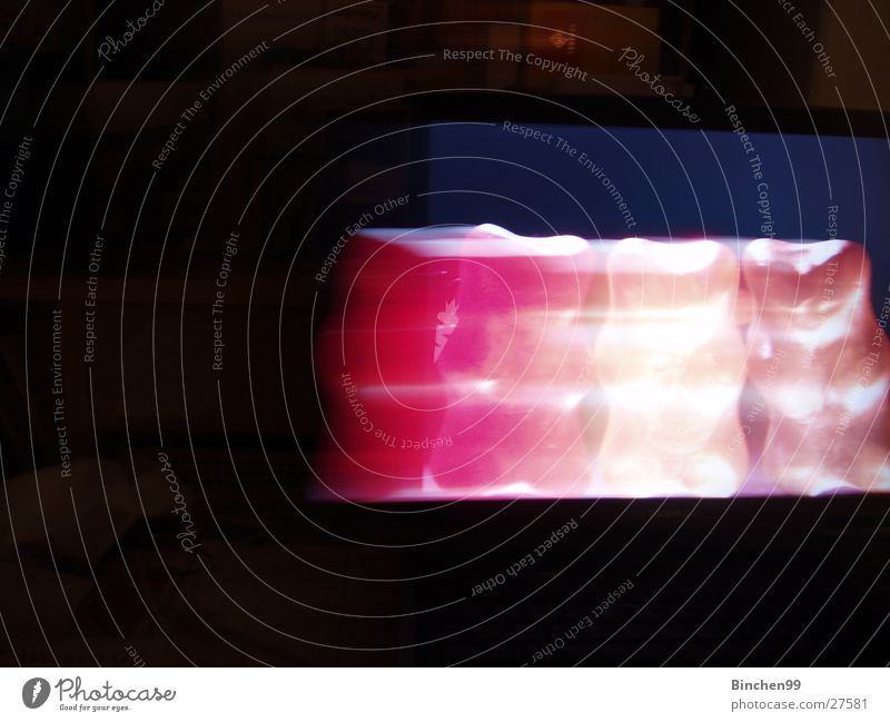 Langgezogen Schreibtisch Hintergrundbild Gummibärchen rot schwarz gelb Weingummi Computer Langzeitbelichtung Bewegung