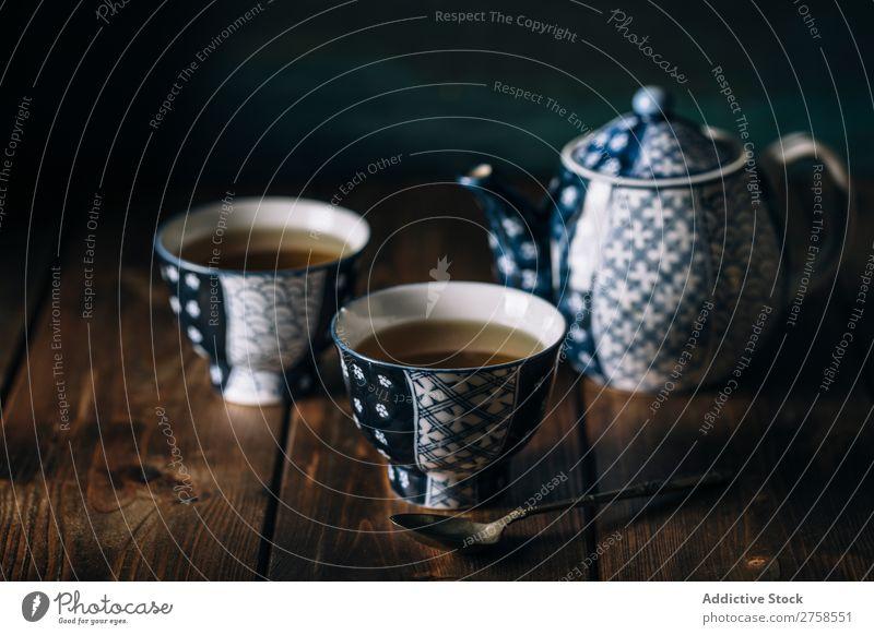 Heißer Tee auf Porzellantassen Antiquität asiatisch Hintergrundbild Getränk blau Keramik China Chinese Nahaufnahme Kultur Tasse dunkel Design trinken Osten