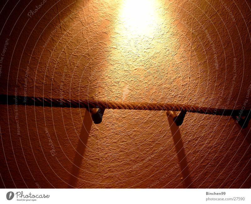 Erleuchtung festhalten Licht Wand Fototechnik Seil Schatten