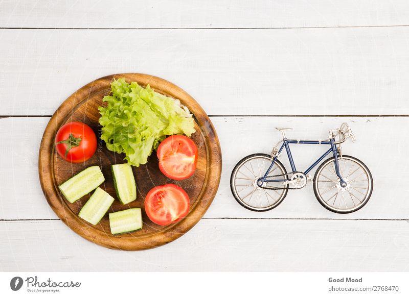 Fahrradmodell und frisches Gemüse Ernährung Essen Diät Lifestyle Stil Körper Erholung Freizeit & Hobby Ferien & Urlaub & Reisen Tourismus Ausflug Tisch Sport