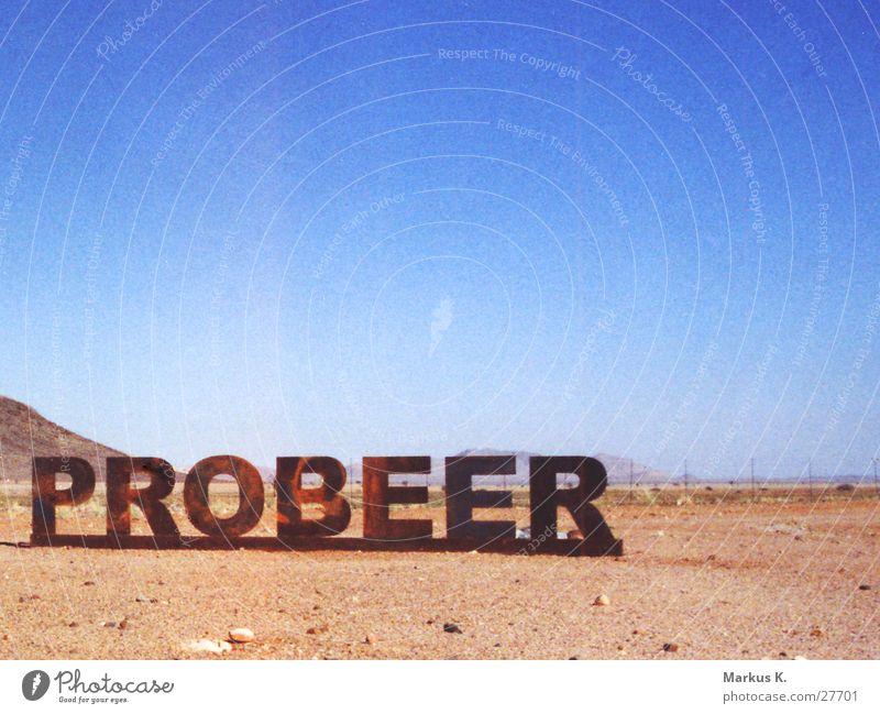 Probeer Typographie Namibia gegen Bier Dinge probeer Wüste Schilder & Markierungen geschweißt dafür