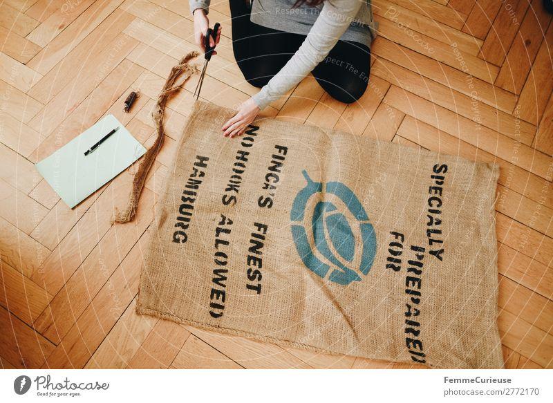 Upcycling - woman making garments from coffee sack Frau Mensch Jugendliche 18-30 Jahre Lifestyle Erwachsene feminin nachhaltig Recycling Parkett Nähen