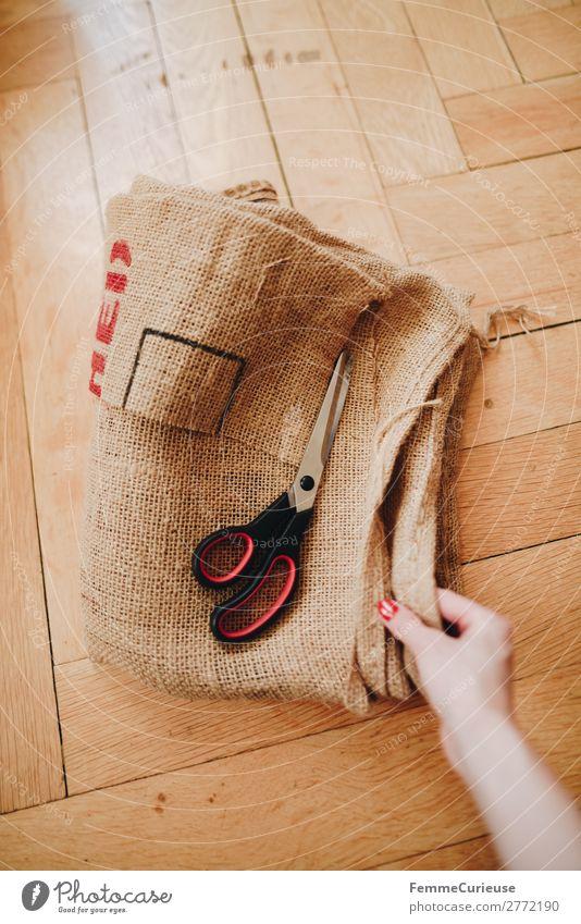 Upcycling - making garments from coffee sack Frau Mensch Jugendliche 18-30 Jahre Lifestyle Erwachsene feminin nachhaltig Material Recycling Schere Parkett