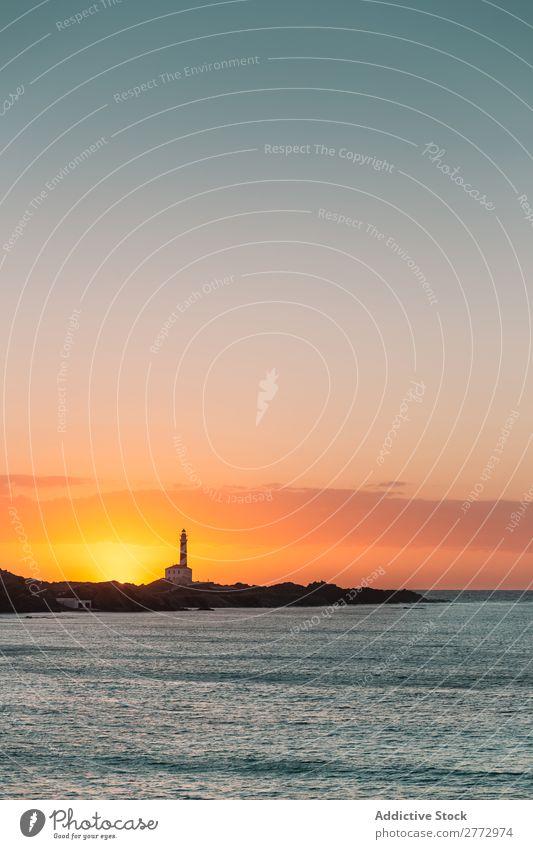 Küste mit Leuchtturm bei Sonnenuntergang Meer Navigation Natur Beautyfotografie Landschaft