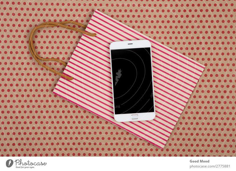 Einkaufstasche, Geschenktaschen und weißes Smartphone kaufen Stil Design Büro Handwerk Business Telefon PDA Bildschirm Technik & Technologie Musiknoten Rudel