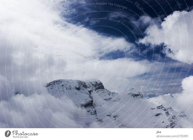 Wolkenverhangen Natur Winter ruhig Landschaft Berge u. Gebirge Leben Schnee Freiheit Luft Felsen Wind wild Tourismus Ausflug authentisch