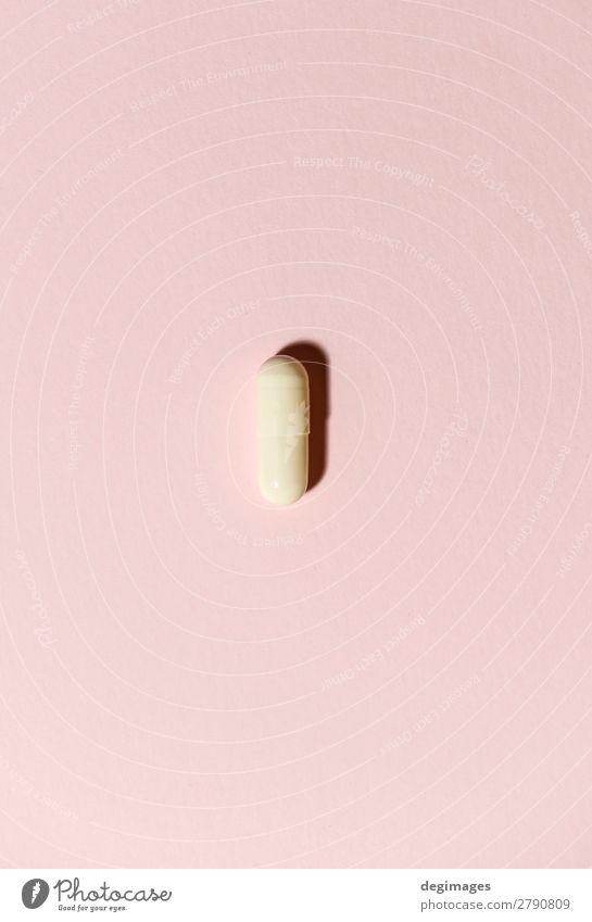 Eine weiße Pille auf orangem Hintergrund. Minimalistisches Konzept Gesundheitswesen Behandlung Krankheit Medikament Wissenschaften Schmerz Tablette Medizin