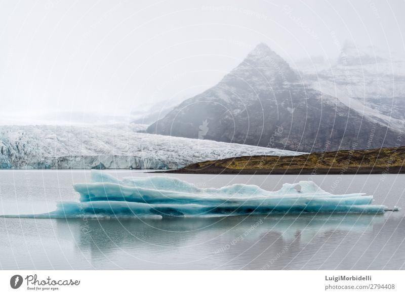 Eisberg in der Fjallsarlon Gletscherlagune, Island Ferien & Urlaub & Reisen Insel Winter Schnee Berge u. Gebirge Natur Landschaft Wasser Himmel