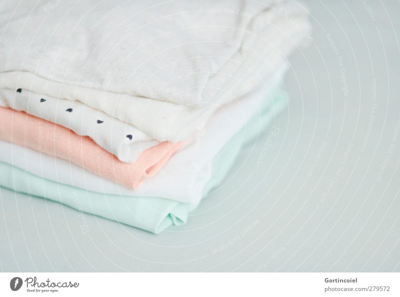 Textil Mode Bekleidung T-Shirt Hemd Stoff hell Sauberkeit Pastellton Bluse orange mint gewaschen Wäsche Stapel Textilien Baumwolle Seide weich Farbfoto