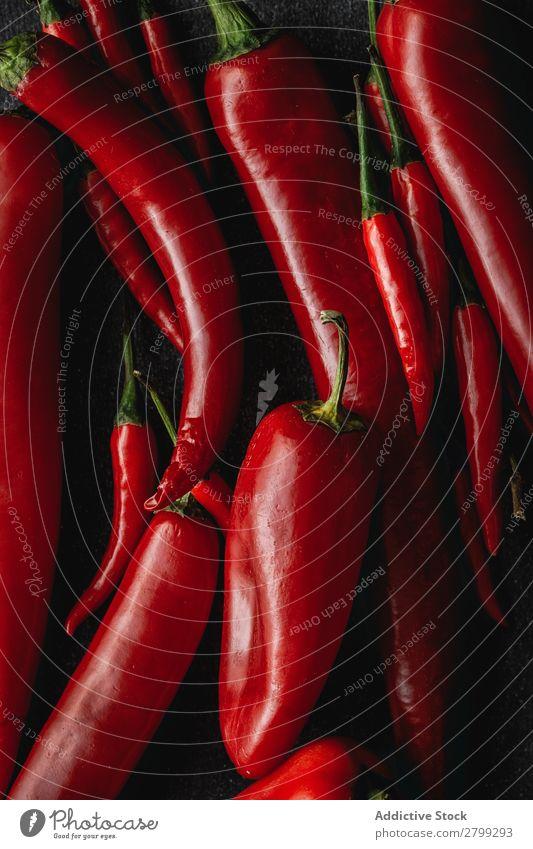 Frische rote und würzige Chilischoten Lebensmittel rot grün grün Gemüse heiß Cayenne frisch Hintergrundbild Pfeffer organisch Zutaten Paprika Makroaufnahme