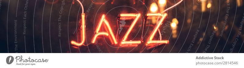 Orangefarbenes Neonlichtschild neonfarbig Zeichen Jazz Licht rot Musik hell erleuchten glühen offen Symbole & Metaphern Nacht glühend Hinweisschild Farbe Design