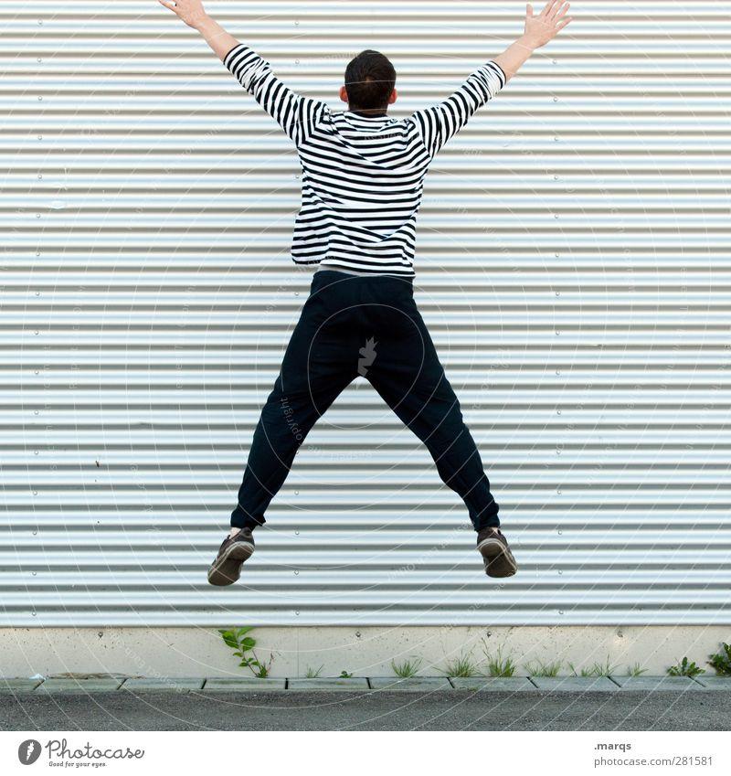 Gegen die Wand Mensch Jugendliche Erwachsene Mauer Junger Mann springen Linie Körper außergewöhnlich Fassade maskulin Streifen sportlich Grenze skurril