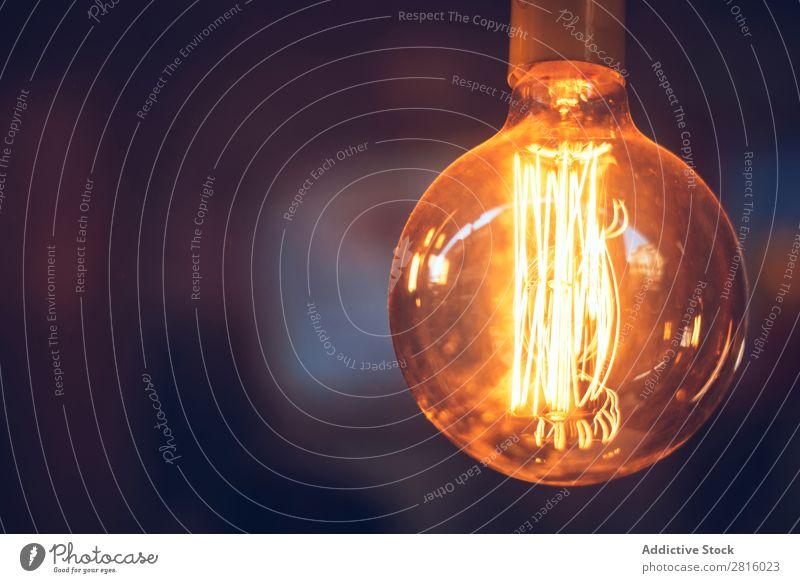 Hintergrund der brennenden Glühbirne Konsistenz Licht Knolle Elektrizität Technik & Technologie glühend texturiert Energie Kraft Idee erleuchten Innovation