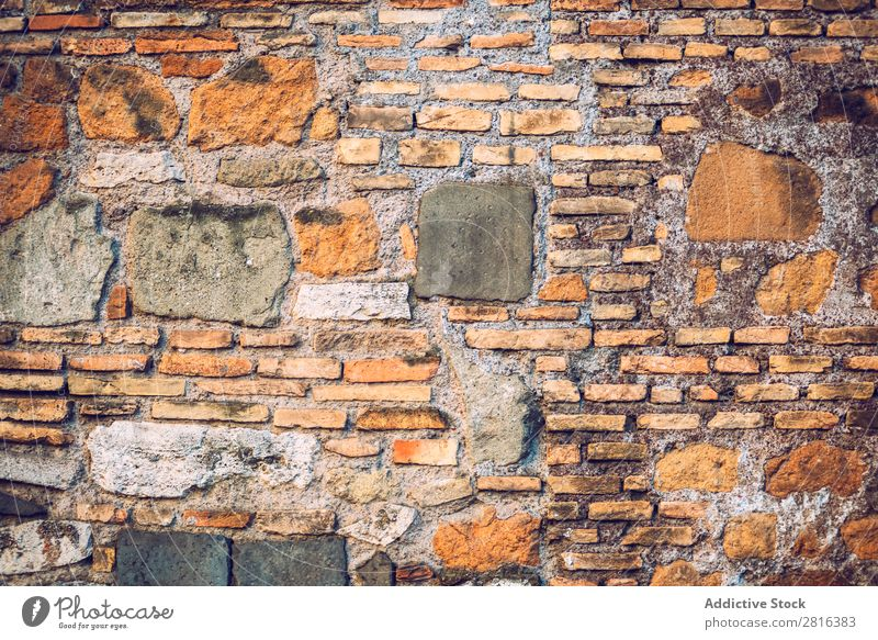 Ziegel- und Steinmauer in Rom, Italien. Textur-Hintergrund Wand Backstein Römer abstrakt antik solide Zement rau dreckig Maurer alt grau Beton Konsistenz Design
