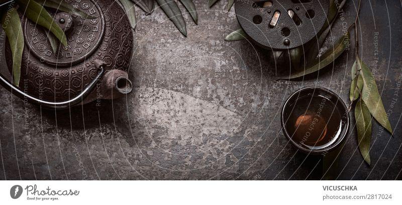 Asiatische grüner Tee in Gusseisen Teebecher mit Teekanne Lebensmittel Ernährung Diät Getränk Heißgetränk kaufen Stil Gesundheit Alternativmedizin