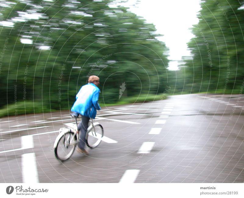 fahrradaction Fahrrad Geschwindigkeit fahren Mann Straße Unschärfe