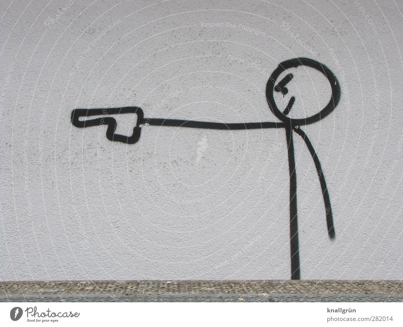 Böse Kunst Jugendkultur Subkultur Mauer Wand Fassade Pistole Waffe Zeichen Graffiti stehen Aggression bedrohlich Stadt schwarz weiß Gefühle Coolness Macht Angst
