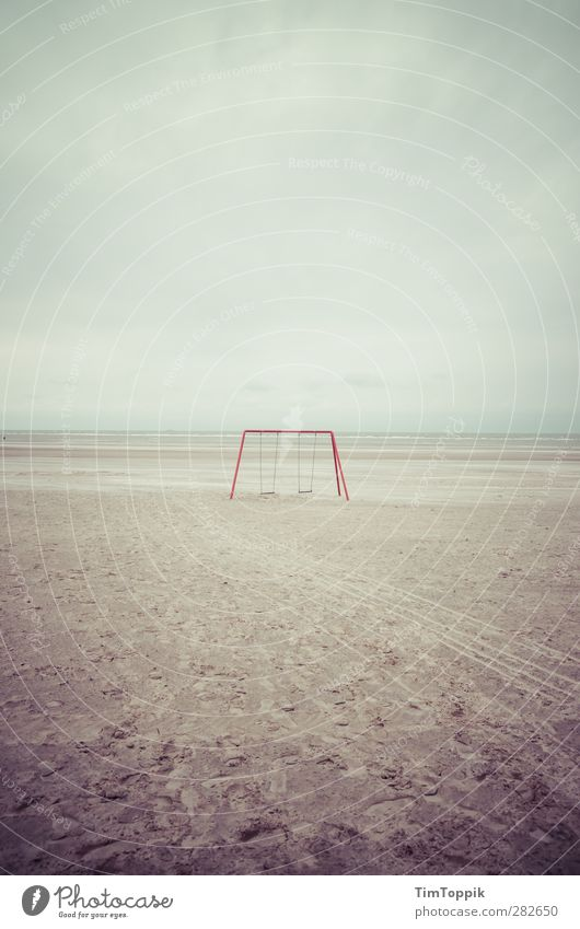 This used to be my playground Meer Einsamkeit Strand Traurigkeit Kindheit trist Insel Kindheitserinnerung Sandstrand Schaukel Kinderspiel erinnern Langeoog