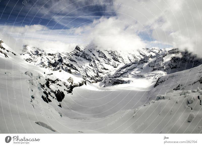 Gletscher Leben Tourismus Freiheit Winter Schnee Berge u. Gebirge Natur Landschaft Wolken Schönes Wetter Eis Frost Felsen Alpen Gipfel Schneebedeckte Gipfel