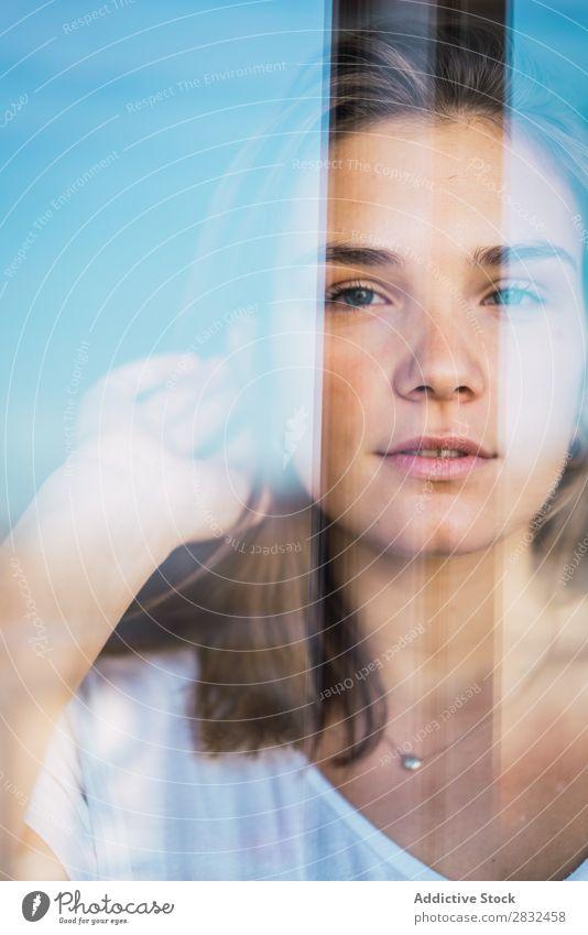 eb19a929ba066 Schöne junge Frau durch Glas - ein lizenzfreies Stock Foto von Photocase