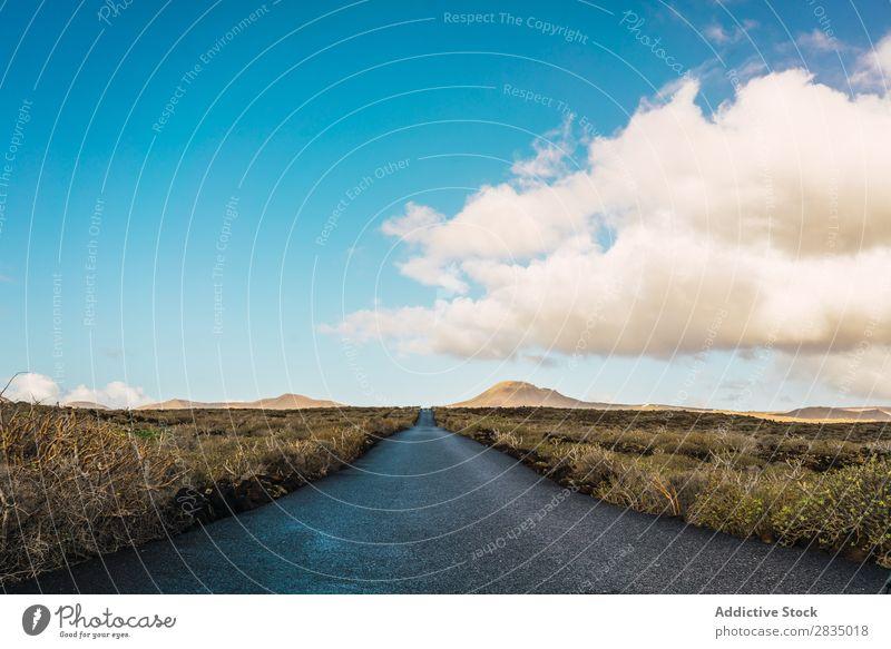 Landschaft der Straße im Feld regenarm Wolken Natur natürlich Felsen Stein