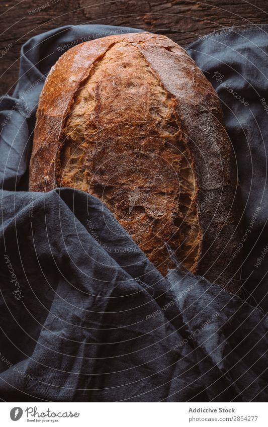 Rustikaler Laib aus handwerklichem Brot backen Bäckerei Kohlenhydrat dunkel Mehl Lebensmittel frisch selbstgebacken Brotlaib Stimmung rustikal Weizen