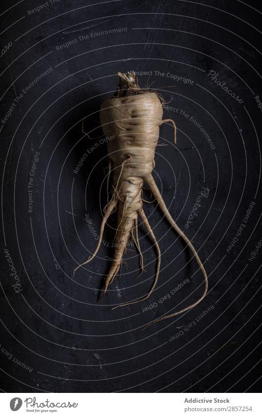 Frischer Pastinak auf dunklem Hintergrund Landwirtschaft Antioxidans Hintergrundbild Knolle dunkel Diät Geschmack Lebensmittel frisch grün Gesundheit