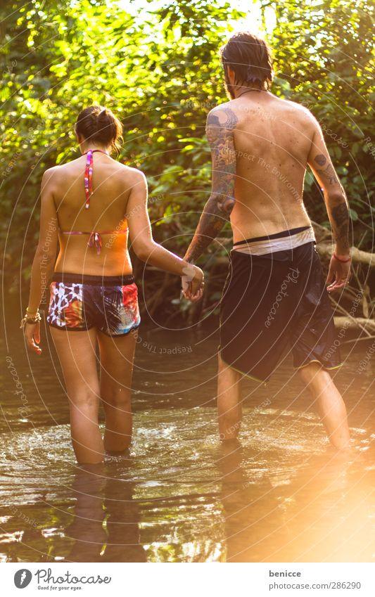 two in water Frau Natur Mann Wasser Hand Sommer Sonne Liebe Frühling See Paar Zusammensein Schwimmen & Baden gehen orange paarweise