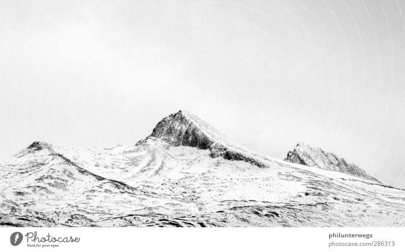 Blyant Ferien & Urlaub & Reisen weiß Wolken Winter Landschaft schwarz Erholung Ferne Berge u. Gebirge kalt Schnee grau Freiheit Felsen Eis Klima