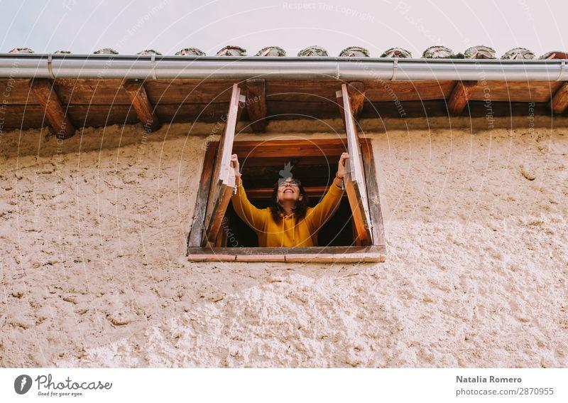 eine junge Frau öffnet das Fenster eines Landhauses. Lifestyle Freude schön Gesundheit Sinnesorgane Meditation Kur Freizeit & Hobby Ferien & Urlaub & Reisen