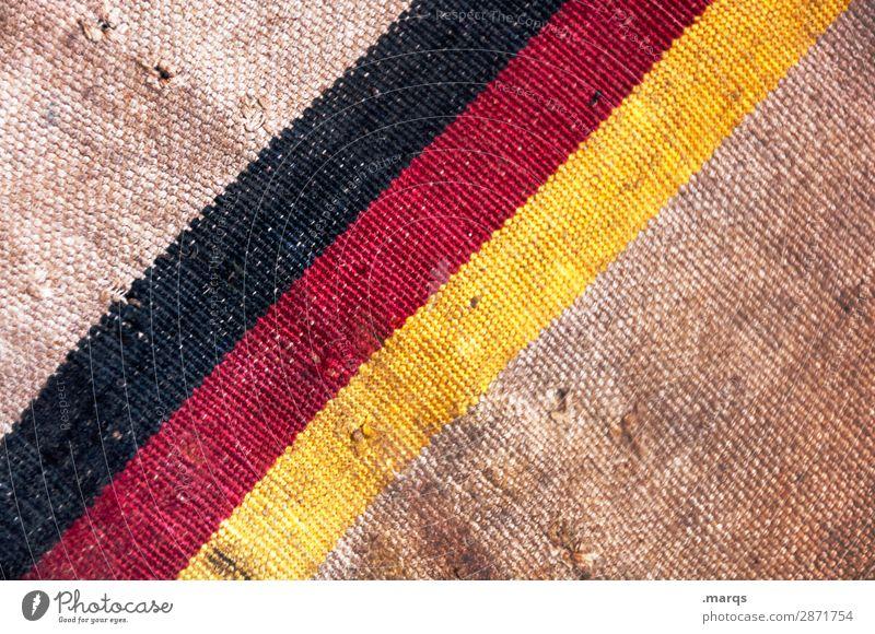 Flagge auf Postsack Güterverkehr & Logistik Dienstleistungsgewerbe Deutsche Flagge Stoff alt dreckig braun gelb rot schwarz Politik & Staat Farbfoto