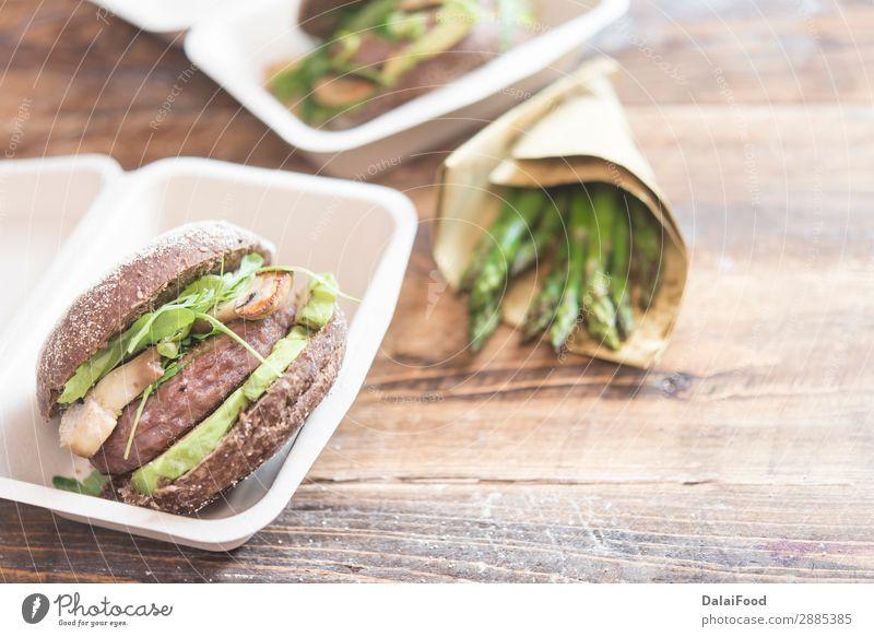 Entfernen Sie keine Abfälle für das Büro. Fleisch Käse Brot Brötchen Essen Mittagessen Abendessen Kaffee Tisch Papier Verpackung Holz heiß lecker weiß