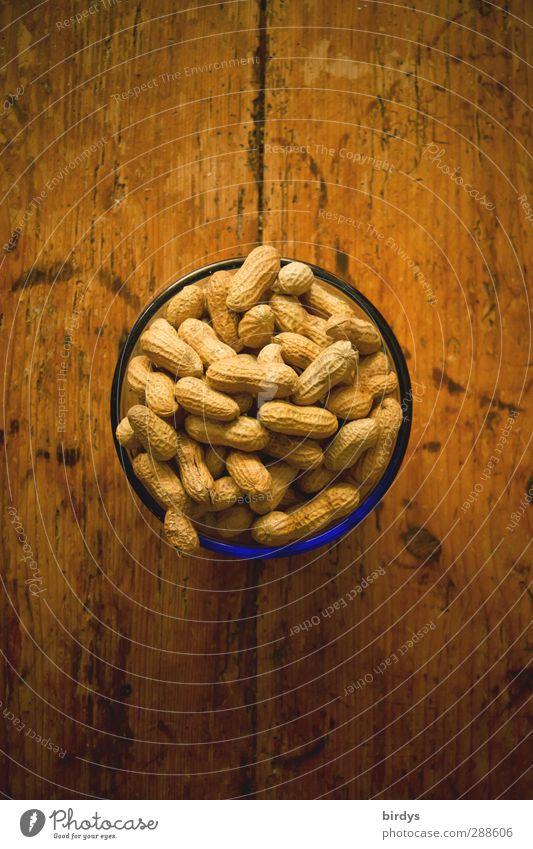 Peanuts Erdnuss Schalen & Schüsseln Tisch Holztisch genießen lecker rund Snack Knabbereien Nuss Foodfotografie Farbfoto Innenaufnahme Menschenleer