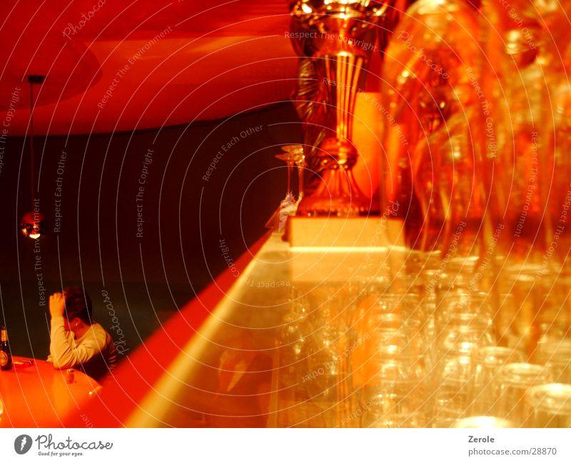 An der Bar Stil orange Glas trinken Fototechnik