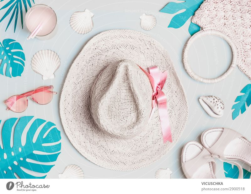 Summer woman accessories with  shells and tropical leaves on pastel color background, top view. Straw hat, sunglasses, sandals and handbag. Holiday vacation. Female fashion outfit