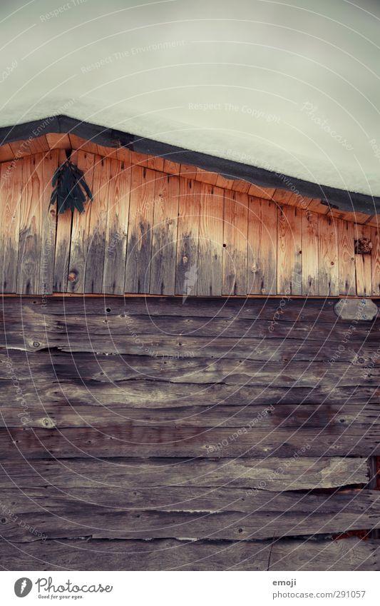 Hüttengaudi Winter Schnee Holz Holzwand Haus Mauer Wand einzigartig kalt Hüttenferien Alm Farbfoto Außenaufnahme Menschenleer Textfreiraum oben