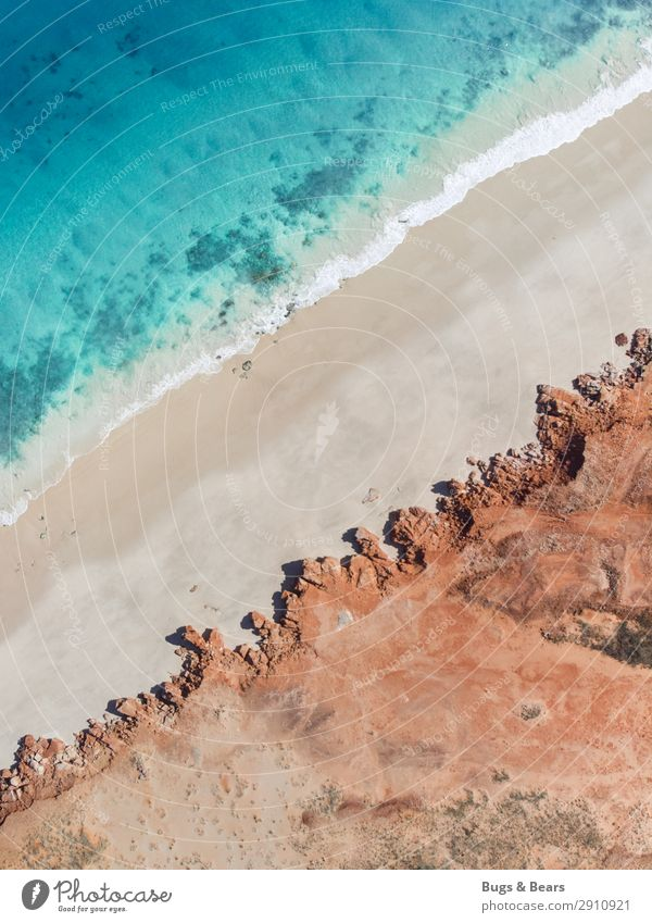 Küste Natur Landschaft Urelemente Erde Sand Wellen Strand Bucht Riff Meer Insel Abenteuer Australien Klippe türkis rot Reisefotografie ästhetisch beruhigend