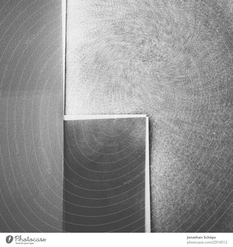 grafisches Hintergrundbild Schwarzweiß Textfreiraum leuchten Papier Ecke einfach graphisch Doppelbelichtung Basteln Geometrie Entwurf Karton minimalistisch
