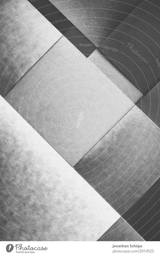 grafisches Hintergrundbild Schwarzweiß Basteln Papier leuchten einfach grau schwarz Buntpapier Quadrat flach Geometrie graphisch grell Entwurf minimalistisch