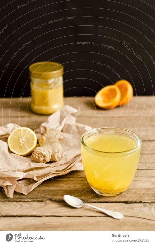 Zitrus-Ingwer-Tee Lebensmittel Orange Getränk Heißgetränk Glas Löffel frisch Gesundheit heiß lecker braun gelb schwarz Foodfotografie Honig Zitrone Erkältung