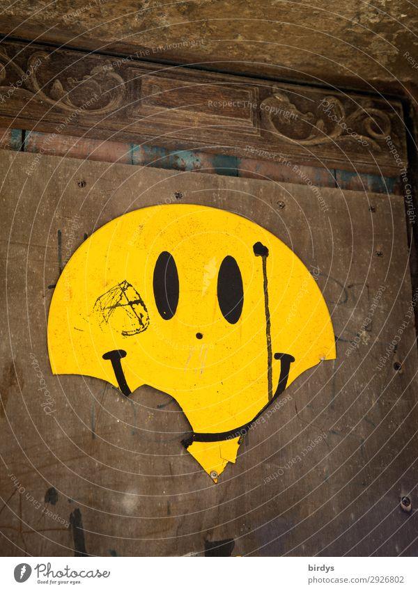 Angefressen Mauer Wand Zeichen Smiley Emotiondesign Lächeln lachen Blick authentisch frech einzigartig kaputt positiv rund braun gelb Freude Fröhlichkeit