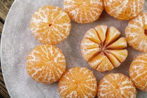 frische Clementine Gesunde Ernährung Weihnachten & Advent Farbe Gesundheit Lebensmittel gelb natürlich orange grau Frucht süß genießen einfach lecker rein
